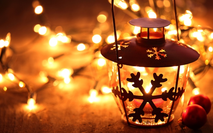 snowflake-lantern-on-wooden-floor-with-yellow-candle-light-706